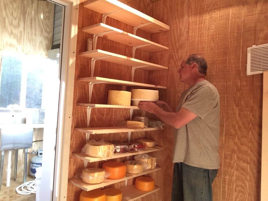 Finally, putting some natural rind wheels above last year's waxed and sealed cheeses!