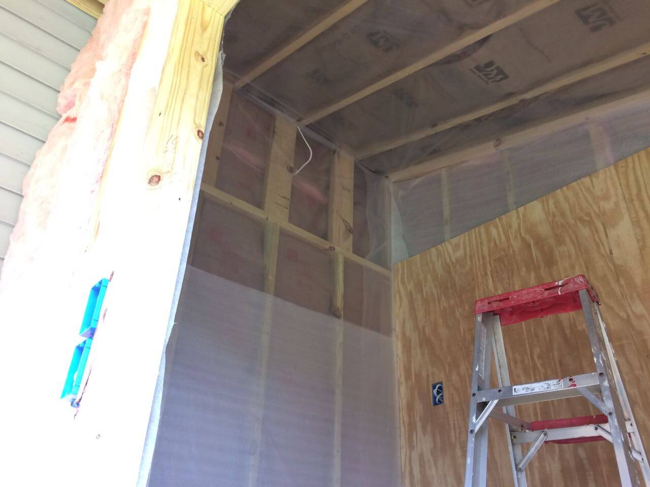 Maintaining high humidity is crucial, so we covered the insulation and walls with a moisture barrier.